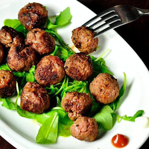 meatballs on spinach